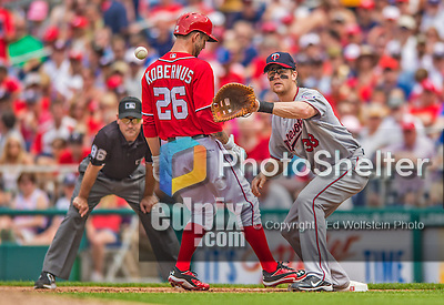 9 June 2013: Minnesota Twins first baseman Justin Morneau takes a pick-off attempt during a game against the Washington Nationals at Nationals Park in Washington, DC. The Nationals shut out the Twins 7-0 in the first game of their day/night double-header. Mandatory Credit: Ed Wolfstein Photo *** RAW (NEF) Image File Available ***
