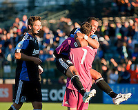 SANTA CLARA, CA – July 12, 2011: San Jose Earthquakes defenders Bobby Burling (2) and Jason Hernandez (21) congratulate goalie David Bingham (1) on his goal during the match between San Jose Earthquakes and West Bromwich Albion at the Buck Shaw Stadium in Santa Clara, California. Final score San Jose Earthquakes 2, West Bromwich Albion FC 1.