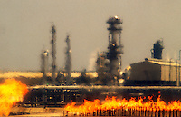 Natural gas liquefication  plant, LNG.  Heat haze rising from burning waste gas.  Bontang, Kalimantan, Borneo.