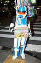 """July 23 2012, Tokyo, Japan - A man wears as a soldier of the Star Wars movie holds up a sign announcing the """"Robot Restaurant"""" at Kabukicho in Shinjuku. The restaurant advertises that cost 10 billion yen (130 million) opening. Robots run by real women dressed in military, perform cabaret dance for its customers, opened in the Kabukicho area, Shinjuku in Tokyo. (Photo by Rodrigo Reyes Marin/AFLO)"""