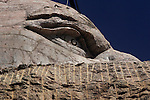 The face of Crazy Horse peers over a blasted away cliff that will be the left arm pointing outward.  Crazy Horse the world's largest sculpture has been in progress since 1947 when sculptor Korczak Ziolkowski (1908-1982) arrived in the Black Hills of South Dakota to accept the Indians invitation to carve a mountain. The Memorial is not a federal or state project.  The project is being continued by Korczak's wife, Ruth, and their large family.  ..9/1/05 Custer South Dakota .Frederic Larson .The San Francisco Chronicle