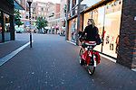 Jess riding her bike in Delft, Holland