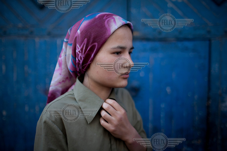 Huorisimen, a 16 year old Uighur girl whose father and two older brothers were arrested following attacks in Urumqi. Ethnic violence between the Uighur and Han Chinese erupted in the city a few days earlier..