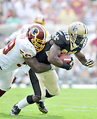 Landover, MD - September 14, 2008 --  Washington Redskins linebacker London Fletcher (59) tackles New Orleans Saints running back Reggie Bush (25) in fourth quarter action at FedEx Field in Landover, Maryland on Sunday, September 14, 2008. The Redskins won the game 29 - 24..Credit: Ron Sachs / CNP.(RESTRICTION: NO New York or New Jersey Newspapers or newspapers within a 75 mile radius of New York City)