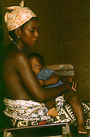 Mother nursing baby, Kpelle tribe, Liberia.