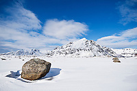 Justadtind mountain peak rises in distance in winter, near Stamsund, Vestvågøy, Lofoten Islands, Norway