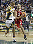 Houston Rockets'  Jon Barry (R) is called for charging foul against Seattle SuperSonics' Ray Allen (L) during the first period of their game at Key Arena in Seattle, Washington Monday, 11 April 2005.  Jim Bryant Photo. &copy;2010. All Rights Reserved.