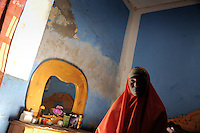 Suweys at her moms place near km. 4 in the center of Mogadishu. .Death or Play. Women&acute;s Basketball in Mogadishu.Women's basketball? In Europa and the U.S., we take it for granted. But consider this: In Mogadishu, war-torn capital of Somalia, young women risk their lives every time they show up to play..Suweys, the captain of the Somali women&acute;s basketball team, and her friends play the sport of the deadly enemy, called America. This is why they are on the hit list of the killer commandos of Al Shabaab, a militant islamist group, that has recently formed an alliance with the terrorist group Al Qaeda and control large swathes of Somalia...Al Shabaab, who sets bombs under market stands, blows up cinemas, and stones women, has declared the female basketball players ?un-islamic?. One of the proposed punishments is to saw off their right hands and left feet. Or simply: shoot them...Suweys&acute; team trains behind bullet-ridden walls, in the ruins of the failed city of Mogadishu - protected by heavily armed gun-men. The women live in constant fear of the islamist killer commandos. Stop playing basketball? Never, they say..Women&acute;s basketball in the world&acute;s most dangerous capital..