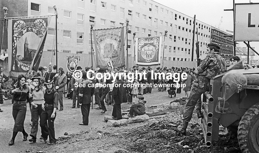 Twelfth, 12th of July, Orangemen's parade, Belfast, N Ireland, UK, 1973 - soldiers keep a watchful eye on the marchers. 197307120503g<br /> <br /> Copyright Image from Victor Patterson, 54 Dorchester Park, Belfast, UK, BT9 6RJ<br /> <br /> t1: +44 28 9066 1296 (from Rep of Ireland 048 9066 1296)<br /> t2: +44 28 9002 2446 (from Rep of Ireland 048 9002 2446)<br /> m: +44 7802 353836<br /> <br /> e1: victorpatterson@me.com<br /> e2: victorpatterson@gmail.com<br /> <br /> The use of my copyright images is subject to my Terms &amp; Conditions.<br /> <br /> It is IMPORTANT that you familiarise yourself with them. They are available on my website at www.victorpatterson.com.<br /> <br /> None of my copyright images may be used on a website or on television unless they are visibly watermarked, i.e. &copy; Victor Patterson within the body of the visible image. The metadata of images used on the Internet must not be removed.<br /> <br /> Copyright acknowledgment of my images is a condition of use.<br /> <br /> Failure to observe the above conditions will incur a penalty of at least 100% of the agreed fee. <br /> <br /> Web use (maximum size - 400 kb) is extra at currently recommended NUJ rates..com
