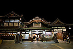 Bathers exit Dogo Onsen, thought to be Japan's oldest spa in Matsuyama City, Ehime Prefecture, Japan on 20 Feb. 2013.  Photographer: Robert Gilhooly