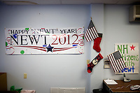 A banner reading &quot;Happy Newt Year&quot; hangs next to American flags on the wall at the Newt Gingrich New Hampshire campaign headquarters in Manchester, New Hampshire, on Jan. 7, 2012. Gingrich is seeking the 2012 Republican presidential nomination.