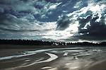Storm clouds over the vast beach at Holkham