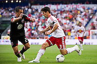 Heath Pearce (3) of the New York Red Bulls is defended by Danny Cruz (2) of DC United. The New York Red Bulls defeated DC United 3-2 during a Major League Soccer (MLS) match at Red Bull Arena in Harrison, NJ, on June 24, 2012.