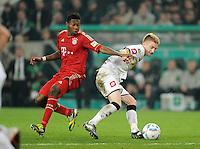 FUSSBALL   DFB POKAL   SAISON 2011/2012   HALBFINALE   21.03.2012 Borussia Moenchengladbach - FC Bayern Muenchen  David Alaba (li, FC Bayern Muenchen) gegen Marco Reus (Borussia Moenchengladbach)