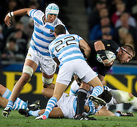 Rugby World Cup Auckland  New Zealand v Argentina Quarter Final 4 - 09/10/2011.Kieran Read  (New Zealand)  tackled by Juan Jose Imhoff (Argentina).Photo Frey Fotosports International/AMN Images