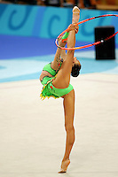 Aliya Yussupova competing for Kazakhstan holds balance (leg behind) with  hoop during qualifications round at Athens Olympic Games on August 26, 2004 at Athens, Greece. (Photo by Tom Theobald)