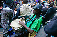 Man plays drums at the Occupy Wall Street Protest in New York City October 6, 2011.