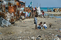 Haitian children play in the slum of Cité Soleil, Port-au-Prince, Haiti, 11 July 2008. Cité Soleil is considered one of the worst slums in the Americas, most of its 300.000 residents live in extreme poverty. Children and single mothers predominate in the population. Social and living conditions in the slum are a human tragedy. There is no running water, no sewers and no electricity. Public services virtually do not exist - there are no stores, no hospitals or schools, no urban infrastructure. In spite of this fact, a rent must be payed even in all shacks made from rusty metal sheets. Infectious diseases are widely spread as garbage disposal does not exist in Cité Soleil. Violence is common, armed gangs operate throughout the slum.