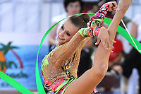 Yana Lukonina of Russia smiles during ribbon routine at 2010 Holon Grand Prix at Holon, Israel on September 4, 2010.  (Photo by Tom Theobald).