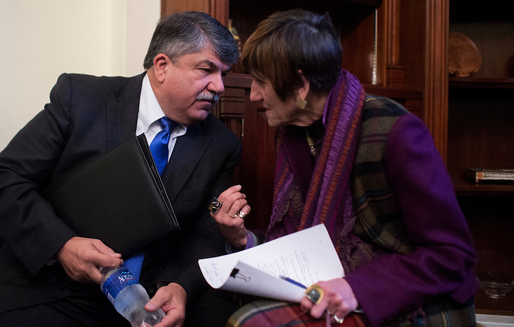 """UNITED STATES - FEBRUARY 3: Rep. Rosa DeLauro, D-Conn., right, speaks with Richard Trumka, president of the AFL-CIO, before their news conference in the Cannon House Office Building on Wednesday, Feb. 3, 2016, to address """"the failings"""" of the Trans-Pacific Partnership. National online groups delivered to Congress more than a million petition signatures in opposition to the TPP. (Photo By Bill Clark/CQ Roll Call)"""