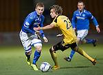 St Johnstone v Livingston.....30.11.13     Scottish Cup 4th Round<br /> Liam Caddis skips by Patrick Twadzik<br /> Picture by Graeme Hart.<br /> Copyright Perthshire Picture Agency<br /> Tel: 01738 623350  Mobile: 07990 594431