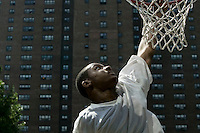 12 June 2005 - New York City, NY - A player makes a basket during tryouts for the Rucker's street basketball tournament, at Rucker Park in Harlem, New York City, USA, Sunday June 12 2005. Photo Credit: David Brabyn