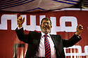 Egyptian Islamist presidential candidate Dr. Mohamed Morsy appears on-stage at a May 17, 2012 campaign rally in the Nile delta city of Benha, Egypt. Morsy, the Muslim Brotherhood's candidate once lagged far behind in the polls, but is now considered a strong underdog candidate because of the legendary organizational machine his group commands during election times. (Photo by Scott Nelson)