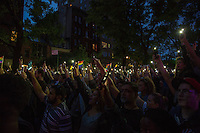 NEW YORK JUNE 13: People hold lights during a vigil in solidarity outside Manhattan's historic Stonewall Inn to express their support for the victims killed at Pulse nightclub in Orlando in New York on June 13 ,2016.Photo by VIEWpress/Maite H. Mateo.