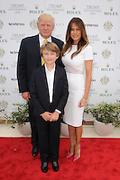 PALM BEACH, FL - JANUARY 05: Donald Trump, Barron Trump, and Melania Trump attend the 2014 Trump Invitational Grand Prix at Club Mar-a-Lago on January 5, 2014 in Palm Beach, Florida. Credit: mpi04/MediaPunch