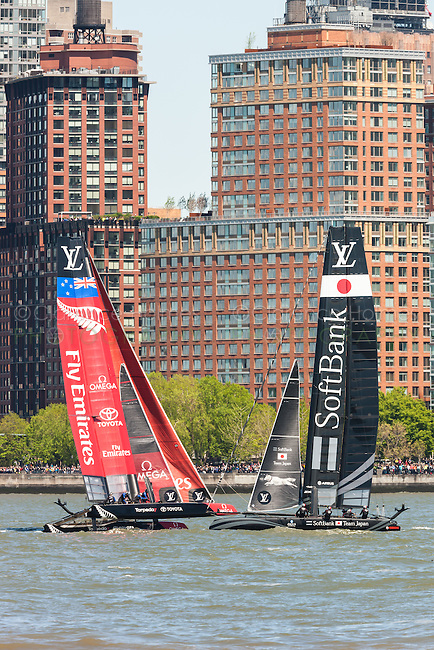 America's Cup World Series teams Japan and New Zealand catamarans race on the Hudson River course near Brookfield Place.