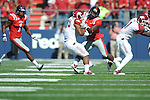 Arkansas running back Dennis Johnson (33) is hit by Ole Miss' Joel Kight (15) at Vaught-Hemingway Stadium in Oxford, Miss. on Saturday, October 22, 2011. .