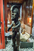 One of the carved wood artifacts on display at a Hawaiian carved tiki exhibit, Bishop Museum, Honolulu, O'ahu.