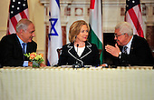 """United States Secretary of State Hillary Rodham Clinton, center, smiles as Prime Minister Benjamin Netanyahu of Israel, left, and Mahmoud Abbas of the Palestinian Authority share some thoughts following their remarks at the start of the """"Relaunch of Direct Negotiations Between the Israelis and Palestinians"""" in the Benjamin Franklin Room of the U.S. Department of State on Thursday, September 2, 2010.  .Credit: Ron Sachs / CNP.(RESTRICTION: NO New York or New Jersey Newspapers or newspapers within a 75 mile radius of New York City)"""