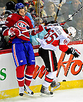 22 March 2010: Montreal Canadiens' left wing forward Benoit Pouliot is checked into the boards during the first period against the Ottawa Senators at the Bell Centre in Montreal, Quebec, Canada. The Senators shut out the Canadiens 2-0 in their last meeting of the regular season. Mandatory Credit: Ed Wolfstein Photo