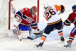 26 October 2009: Montreal Canadiens' goaltender Jaroslav Halak makes a second period save against left wing forward Matt Moulson of the New York Islanders at the Bell Centre in Montreal, Quebec, Canada. The Canadiens defeated the Islanders 3-2 in sudden death overtime for their 4th consecutive win. Mandatory Credit: Ed Wolfstein Photo