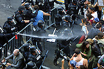 Riot Police spray the crowd with pepper spray  and then forcibly move them back to the corner of SW 5th and Taylor with the further deployment of  pepper balls, rubber bullets and bean bag rounds.
