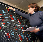 RAF Female admin flight planning at the 'Red Arrows', Britain's Royal Air Force aerobatic team.