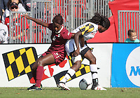 COLLEGE PARK, MD - OCTOBER 21, 2012:  Shade Pratt (22) of the University of Maryland battles with Jessica Price (6) of Florida State during an ACC women's match at Ludwig Field in College Park, MD. on October 21. Florida won 1-0.