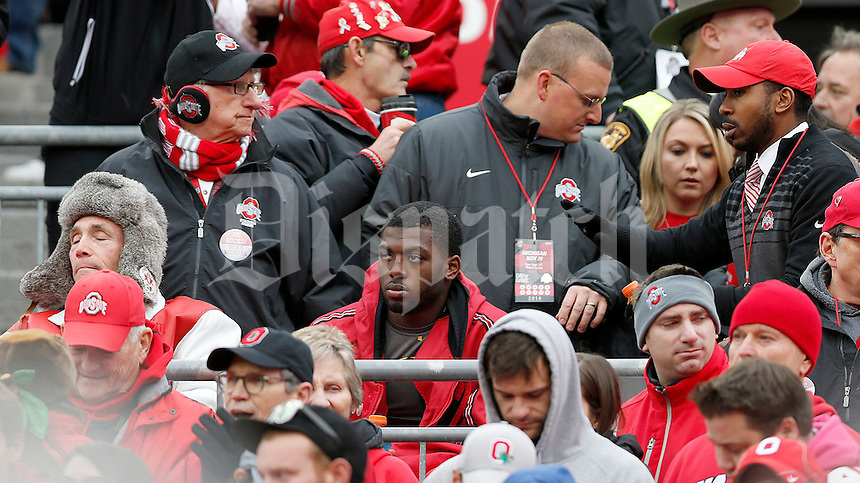 Ohio State Buckeyes quarterback J.T. Barrett (16) sits in the stands for part of the fourth quarter of the NCAA football game against Michigan at Ohio Stadium on Saturday, November 29, 2014. (Columbus Dispatch photo by Jonathan Quilter)