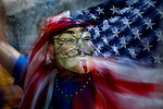 A protester wears a Guy Fawkes mask while protesters of the Occupy Wall Street movement celebrate their first anniversary with marches and confrontations with the New York police where 150 protesters have been arrested during weekend celebrations in Manhattan.  Photo by Eduardo Munoz Alvarez / VIEWpress.