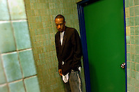 Paul Mayers, 28, of Oak Park, Mich., waits for a turn in the bathroom at Skate World in Troy, Mich., during an adults-only skate jam.