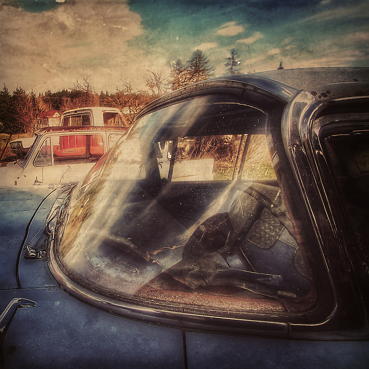 Abandoned car with curved windscreen