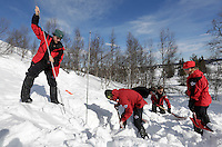 Crew from Norwegian Air Ambulance practice rescue skills at Camp Torpomoen, a training facility..The crew dig in snow, looking for an avalanche victim.
