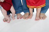 20 July 2008: The ultimate sports family.  USC Trojans NCAA Pac-10 college sports fans pose in studio in Huntington Beach, CA.  Dad Sean Jennings (41), Mom Kim Jennings (32), Meagan Jennings (2) and newborn baby girl Makenna Jennings ( 6weeks).
