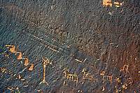 PETROGLYPHS<br /> Glen Canyon, AZ<br /> Petroglyphs are most typically created on surfaces such as cliff walls dark with desert varnish. Pictographs are most typically found in rock shelters, caves or alcoves where the images are protected form elements.