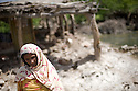 A woman stands in front of her house that was completely destroyed a few days ago after water flooded her village. One month after the devastating monsoon rains caused huge floods in Pakistan, new areas are still affected and water still stands among fields and houses. Jamshoro, Pakistan, 2010