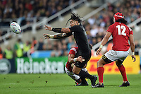Ma'a Nonu of New Zealand offloads the ball after being tackled. Rugby World Cup Pool C match between New Zealand and Tonga on October 9, 2015 at St James' Park in Newcastle, England. Photo by: Patrick Khachfe / Onside Images
