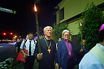 Bishop Heinrich Bedford-Strohm (center) of the Evangelical Church in Germany and Bishop Tor Berger Jorgensen (right) of the Church of Norway participate in a torchlight march for peace in Nagasaki, Japan, on August 9, 2015, the 70th anniversary of the day the United States dropped an atomic bomb on the city. Behind them is the Rev. Baekki Heo of the Korean Christian Church in Japan.<br /> <br /> The procession began with a mass at the Urakami Cathedral--which was destroyed by the bombing and rebuilt years later--and included Bedford-Strohm, Berger Jorgensen, Heo and other members of an ecumenical group of pilgrims from the World Council of Churches who each came to Japan to see for themselves the results of the bombings 70 years ago, to listen to survivors and local church leaders, and to recommit themselves to new forms of advocacy for a world free of nuclear weapons.