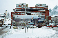 Bosnia and Herzegowina. Republika Serpska. Srebrenica. View on the town and the orthodox church during the winter season. An electoral poster of the elected muslim mayor M. Abdurahman  Malkic stands in the center of the main square. An old commercial and business center destroyed by the war is still empty and a ruin. © 2005 Didier Ruef