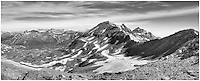 This Colorado landscape black and white image was captured between Crested Butte and Aspen. West Maroon Pass is a great hike for Colorado landscapes and wildflowers. I drove down Gothic Road from Crested Butte in the dark in order to hike early before the afternoon storms rolled in. The previous day I had hiked up Red Cloud and Sunshine Peaks, two of Colorado's 14ers, and by the time I was close to my car, the rains came, so I didn't want to be in that position again.<br /> <br /> The walk to this point is beautiful, and the wildflowers along the trail are quite colorful. In the distance, you can see the peaks of the Maroon Bells, another two of Colorado's iconic 14,000 feet mountains. This Colorado image - a panorama - was taken in mid-July in the morning hours.